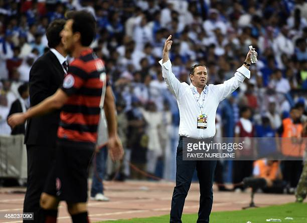 Saudi Arabia's Al Hilal coach Laurentiu Reghecampt reacts during the second leg of the AFC Champions League football final at King Fahad stadium in...