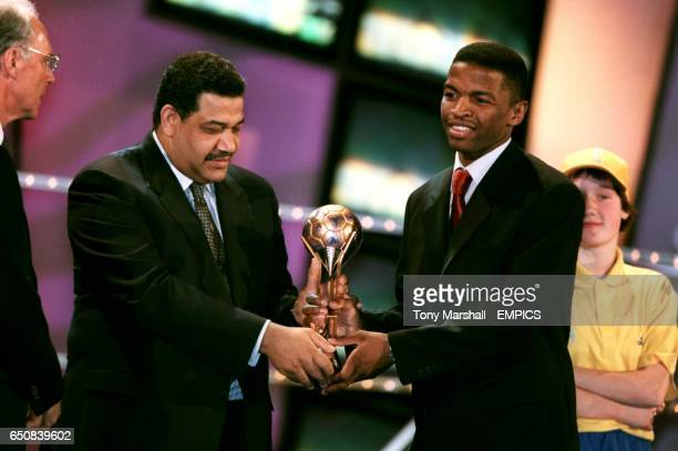 Saudi Arabia's Al Otaibi Marzouk is presented with his best player Adidas Bronze Ball for the FIFA Confederations Cup in Mexico '99