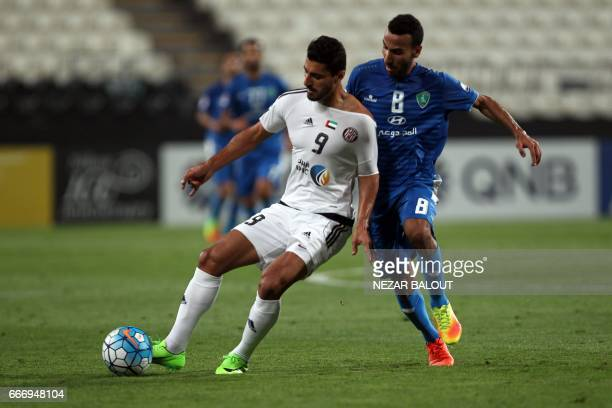 Saudi Arabia's AlFateh ANouh Ibrahim Almousa fights for the ball against UAE's alJazira's Ailton Almeida during their AFC Champions League Group B...
