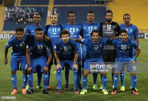 Saudi Arabia's AlFateh club first eleven pose for a team photo prior to the AFC Champions League football match between AlFateh club and Iran's...