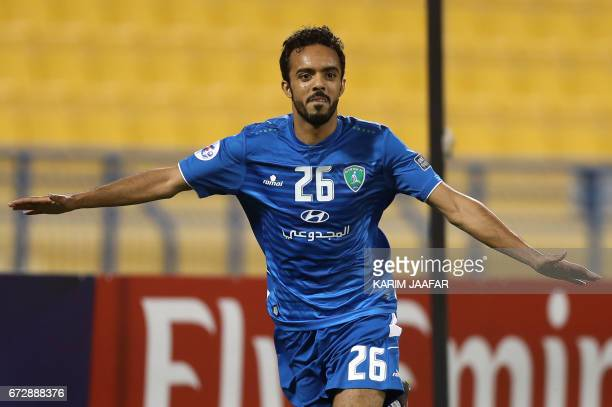 Saudi Arabia's AlFateh FC midfielder Ali Ahmed AlZaqan celebrates after scoring a goal during the AFC Champions League football match between AlFateh...