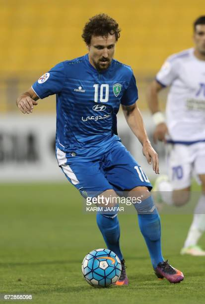 Saudi Arabia's AlFateh FC midfielder Andre Filipe Monteiro dribbles the ball during the AFC Champions League football match between AlFateh club and...