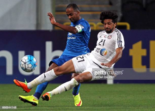 Saudi Arabia's AlFateh Hamdan AlHamdan fights for the ball against UAE's alJazira's Yaqoub Yousif during their AFC Champions League Group B match at...