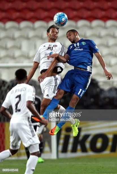 Saudi Arabia's AlFateh Joao Carlos Chaves fights for the ball against UAE's alJazira's Hamad Saud AlJuayyim during their AFC Champions League Group B...
