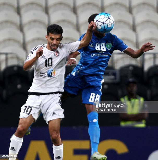 Saudi Arabia's AlFateh Mbark Boussoufa fights for the ball against UAE's alJazira's Majed Hussain during their AFC Champions League Group B match at...