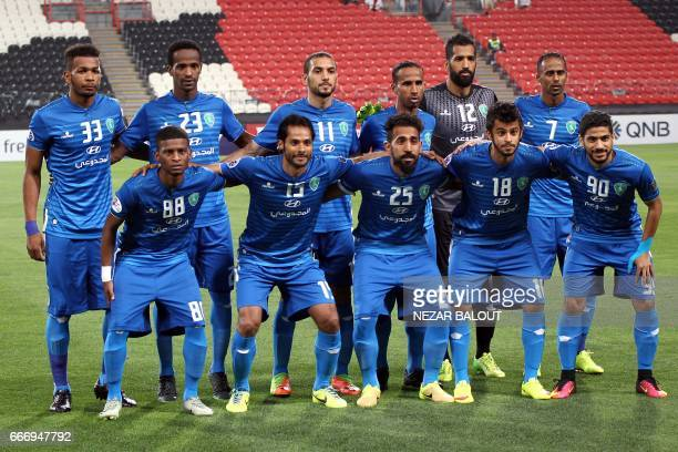 Saudi Arabia's AlFateh players pose for a group photo ahead of their AFC Champions League Group B match at the Mohammed Bin Zayed Stadium in Abu...