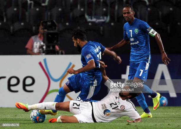Saudi Arabia's AlFateh Tawfiq Hejji Bu Haymid fights for the ball against UAE's alJazira's Yaqoub Yousif during their AFC Champions League Group B...