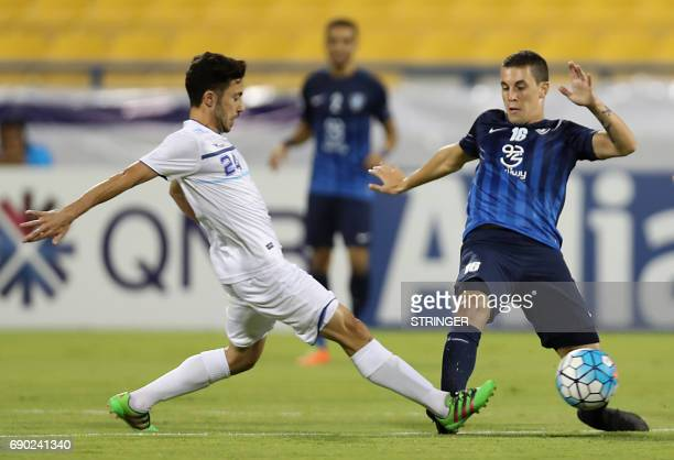 Saudi Arabia's AlHilal midfielder Nicolas Milesi and Iran's Esteghlal Khouzestan midfielder Aliasghar Ashouri vie for the ball during the AFC...