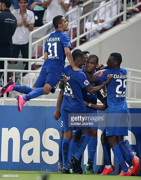 Saudi Arabia's AlHilal players celebrate after scoring the second goal against Lekhwiya during their AFC Championship league quarterfinal football...