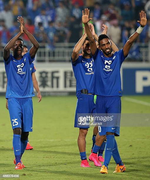 Saudi Arabia's AlHilal players celebrate at the end of their AFC Championship league quarterfinal football match against Lekhwiya at the Lekhwiya...