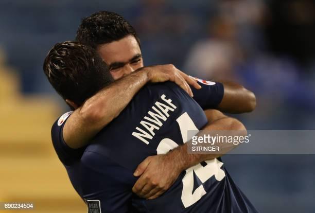 Saudi Arabia's AlHilal SFC Omar Khribin celebrates with his teammate Nawaf alAbid after scoring a goal during the AFC Champions League football match...