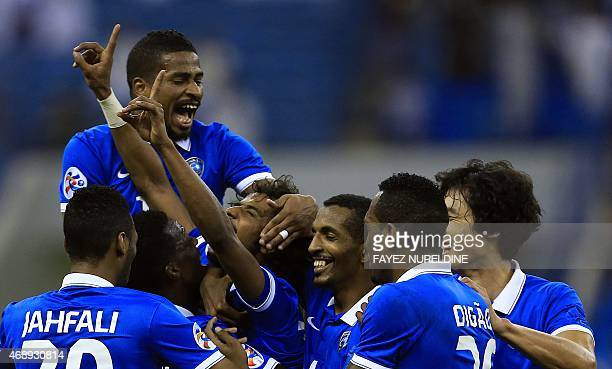Saudi Arabia's AlHilal's players celebrate after scoring against Iran's Foolad during their AFC Champions League group C football match on April 8 at...