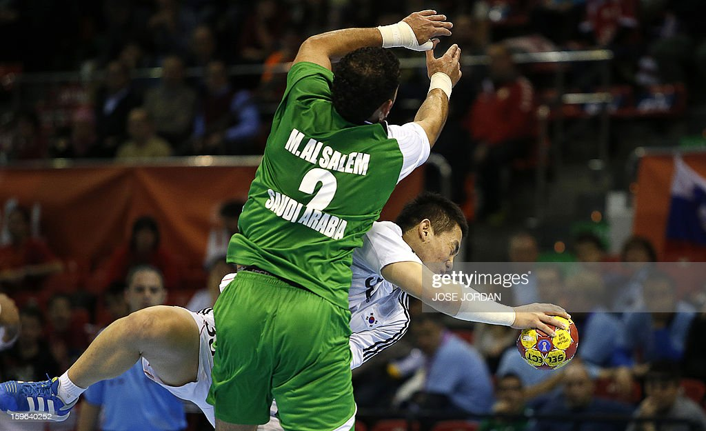 Saudi Arabia's centre back Mahdi Alsalem (L) vies with Korea's centre back Eom Hyo-Won during the 23rd Men's Handball World Championships preliminary round Group C match Saudi Arabia vs South Korea at the Pabellon Principe Felipe in Zaragoza on January 17, 2013.