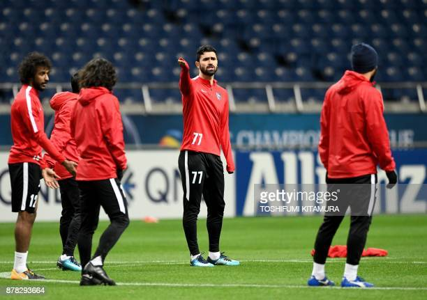 Saudi Arabia's club team AlHilal forward Omar Khrbin instructs teammates during their official training session one day before the AFC Champions...