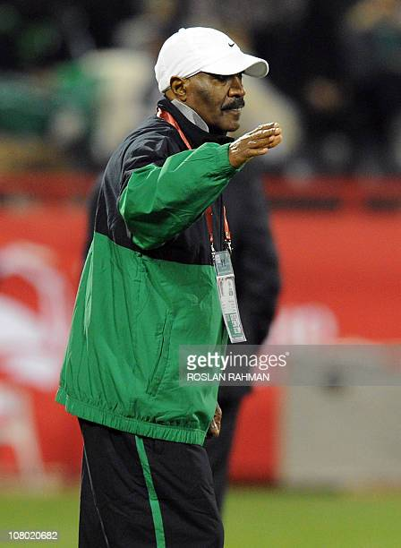 Saudi Arabia's coach Nasser alJohar gestures during his team's 2011 Asian Cup group B football match against Jordan at the AlRayyan Stadium in the...