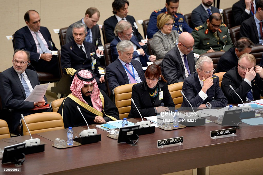 Saudi Arabia's Defence Minister Prince Salman Bin Abdulaziz, Slovenia's Defence Minister Andreja Katic and Spanish Defence Minister Pedro Morenes Eulatelisten to an unseen speaker during the Global Coalition meeting against The Islamic State group IS, held at NATO headquarter in Brussels on February 11, 2016. / AFP / THIERRY CHARLIER