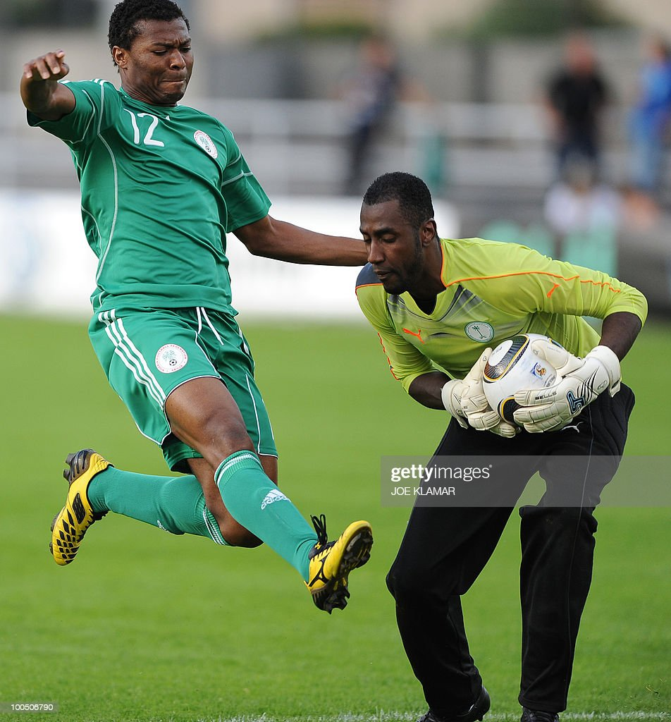 Saudi Arabia's goalie Ali Abdullah Waleed (R) stops Nigeria's Kalu Uche during their friendly match Saudi Arabia against Nigeria in Alpen stadium in Tyrolian Wattens on May 25, 2010 prior to the FIFA World Cup 2010 hosted by South Africa.