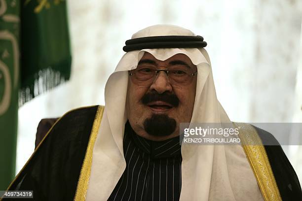 Saudi Arabia's King Abdullah bin Abdulaziz alSaud attends a meeting with French President Francois Hollande at the Saudi Royal palace in Riyadh on...