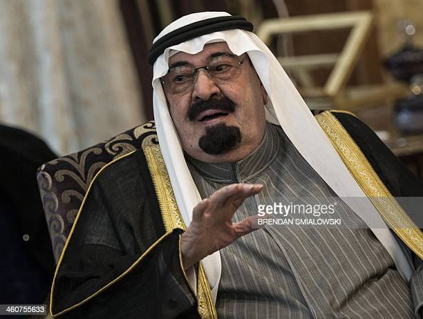 Saudi Arabia's King Abdullah bin Abdulaziz alSaud speaks with the US Secretary of State during a meeting at the King's desert encampment on January 5...