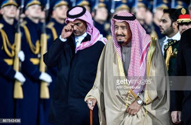 Saudi Arabia's King Salman bin Abdulaziz Al Saud walks past Russian honour guards upon his arrival at Moscow's Vnukovo Airport on October 4 2017 /...