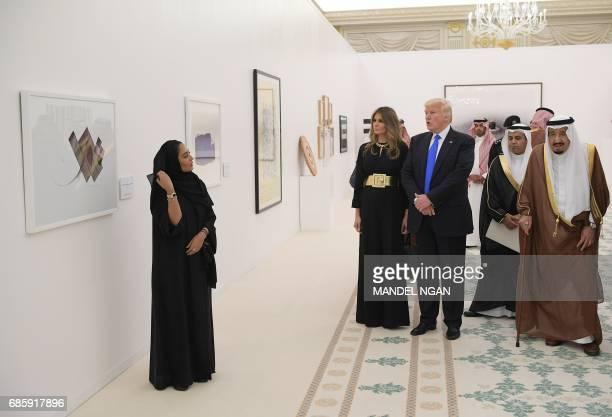 Saudi Arabia's King Salman bin Abdulaziz alSaud US President Donald Trump and US First Lady Melania Trump look at a display of Saudi modern art at...