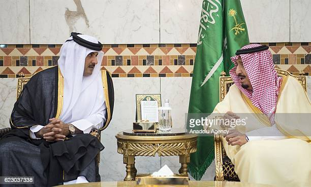 Saudi Arabia's King Salman Bin Abdulaziz meets Emir of Qatar Sheikh Tamim bin Hamad Al Thani to receive condolences after one of his brothers Saudi...