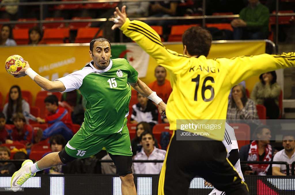 Saudi Arabia's left wing Sultan Alobaidi (L) shoots at Korea's goalkeeper Kang Il-Koo during the 23rd Men's Handball World Championships preliminary round Group C match Saudi Arabia vs South Korea at the Pabellon Principe Felipe in Zaragoza on January 17, 2013. Saudi Arabia won 24-22.
