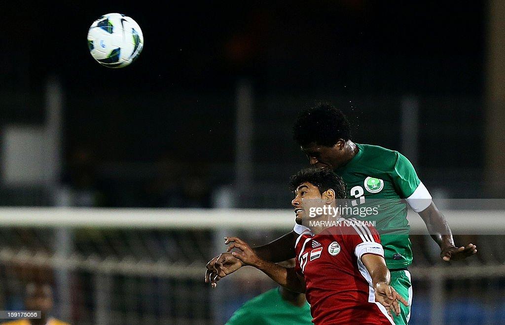 Saudi Arabia's Motaz al-Mousa (R) heads the ball behind Yemen's Kameel Tareq Mahammed during their 21st Gulf Cup football match in the Bahraini capital Manama on January 9, 2013.