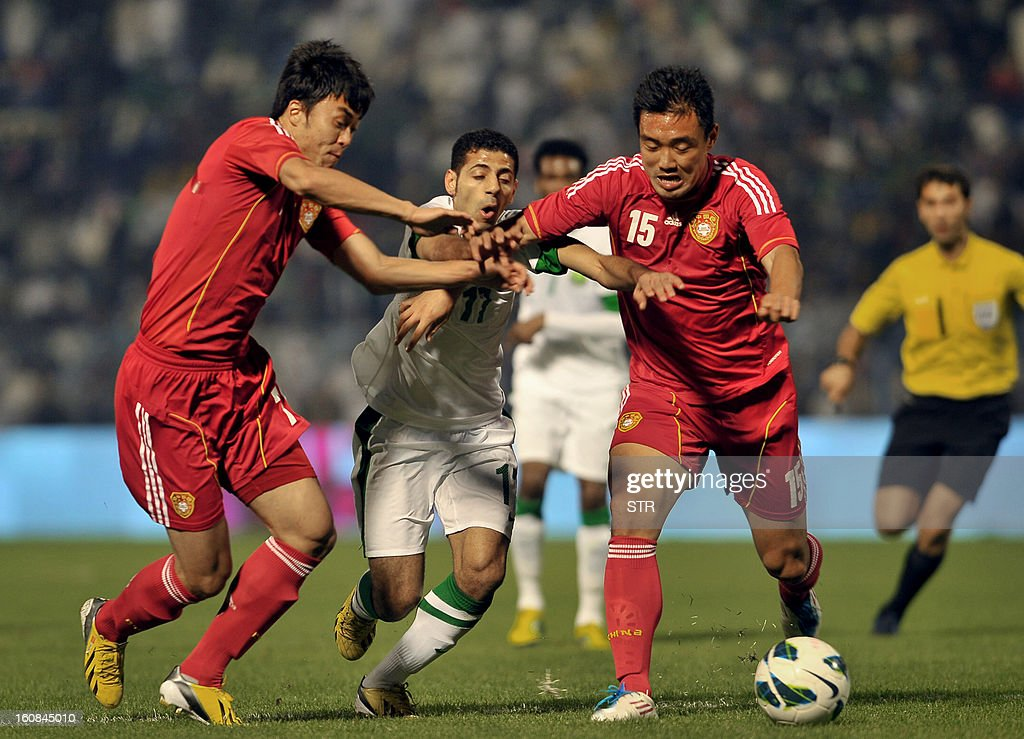 Saudi Arabia's player Nassir Al Shamrani (C) fights for the ball with Chinese player Xo Bo (R) and his teammate Zhao Xuri during the 2014 World Cup Asian zone qualifying football match between Saudi Arabia and China in Dammam on February 7, 2013. STR