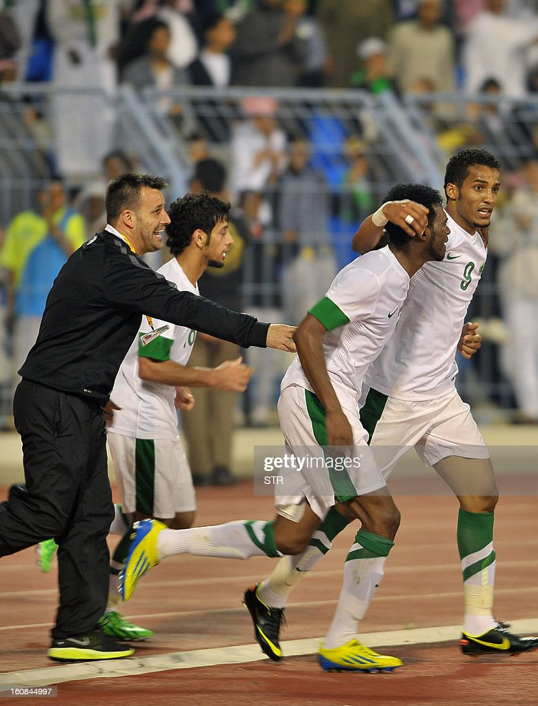 Saudi Arabia's player Nayef Hazazi (L) and his teammates celebrate after a goal was scored against China during the 2014 World Cup Asian zone qualifying football match between Saudi Arabia and China in Dammam on February 7, 2013. STR