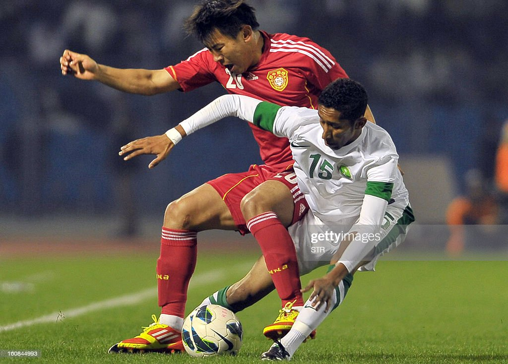 Saudi Arabia's player Salman Al Faraj (R) competes with Chinese player Yu Hanchao during the 2014 World Cup Asian zone qualifying football match between Saudi Arabia and China in Dammam on February 7, 2013. STR