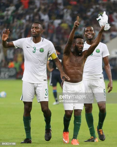 Saudi Arabia's players celebrate after winning the FIFA World Cup 2018 qualification football match between Saudi Arabia and Japan at King Abdullah...