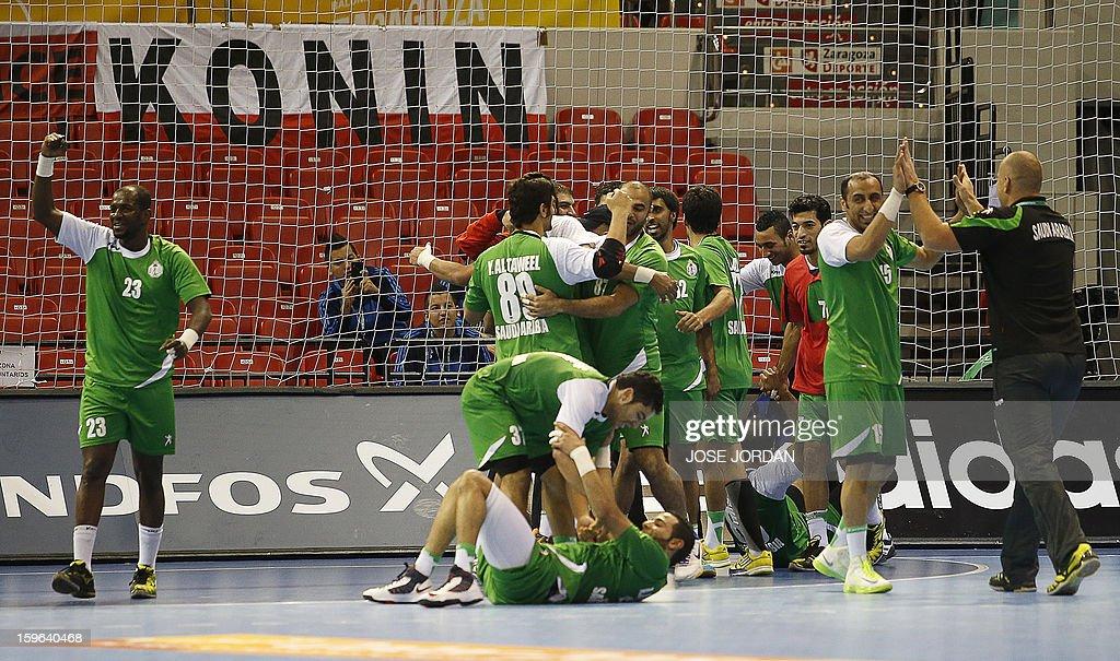 Saudi Arabia's players celebrate their victory over Korea during the 23rd Men's Handball World Championships preliminary round Group C match Saudi Arabia vs South Korea at the Pabellon Principe Felipe in Zaragoza on January 17, 2013. Saudi Arabia won 24-22.
