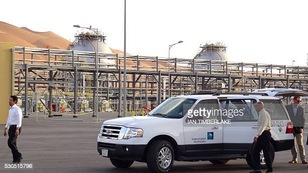 A Saudi Aramco car with visiting journalists is seen outside the company's Natural Gas Liquids plant in Saudi Arabia's remote Empty Quarter near the...