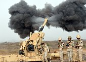 Saudi army artillery fire shells towards Yemen from a post close to the SaudiYemeni border in southwestern Saudi Arabia on April 13 2015 Saudi Arabia...