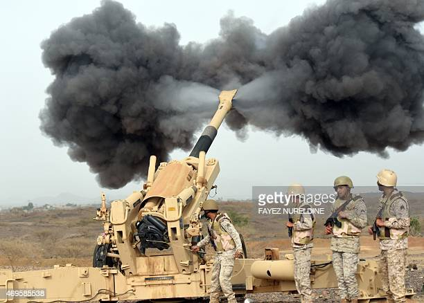 Saudi army artillery fire shells towards Yemen from a post close to the SaudiYemeni border in southwestern Saudi Arabia on April 13 2015 Saudi Arabia...