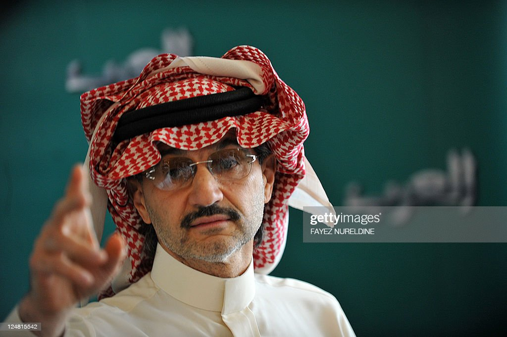 Saudi billionaire owner of Kingdom Holding Company Prince Alwaleed bin Talal gestures during a press conference, on September 13, 2011, in Riyadh. Prince Alwaleed bin Talal announced the launching a new international news channel 'Alarab' scheduled to air in 2012. Alarab will focus editorially on the important shifts taking place in the Arab world with emphasis on freedom of speech and freedom of the press. Alarab channel will target Arabic-speaking viewers across the Arab world and beyond.