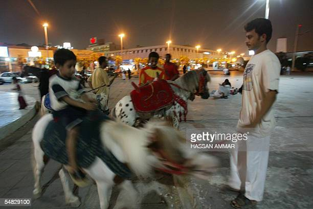Saudi boy enjoys a ride on the back of a pony at the corniche of the Red Sea port of Jeddah 05 September 2005 Saudi security forces exchanged...
