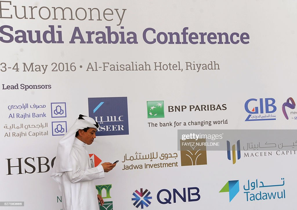 A Saudi businessman checks his mobile during the Euromoney Saudi Arabia conference in the capital Riyadh on May 3, 2016. The two-day conference focuses on Saudi Arabia's economy and the so called economic plan 'Vision 2030'. / AFP / FAYEZ