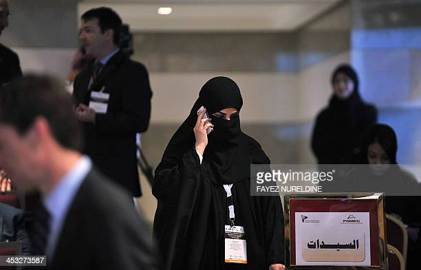 A Saudi businesswoman speaks on her mobile during the Private Sector Middle East Conference in Riyadh on December 3 2013 AFP PHOTO/FAYEZ NURELDINE