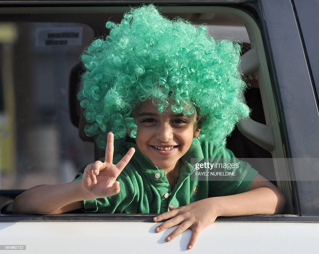A Saudi child flashes the V-sign for victory during celebrations marking the 83rd Saudi Arabian National Day in the desert kingdom's capital Riyadh, on September 23, 2013.