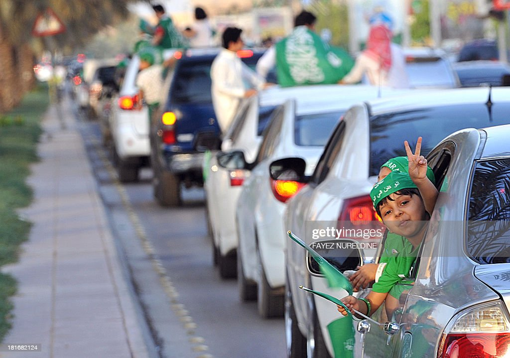 A Saudi child flashes the V-sign for victory during celebrations marking the 83rd Saudi Arabian National Day in the desert kingdom's capital Riyadh, on September 23, 2013. AFP PHOTO/FAYEZ NURELDINE