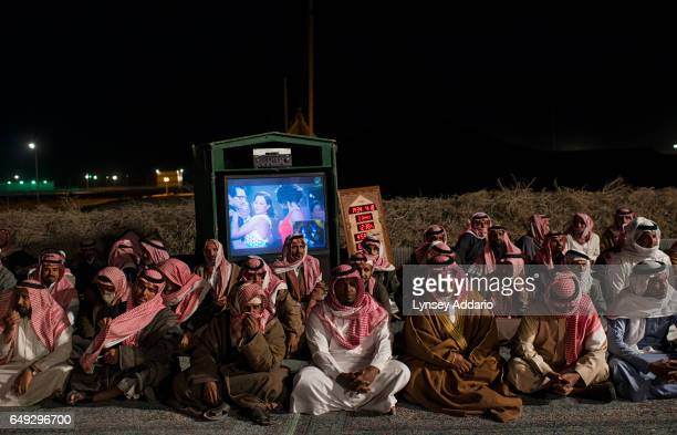 Saudi citizens rest after presenting Saudi billionaire HRH Prince al Waleed bin Talal with petitions for his help at a desert camp outside of Riyadh...