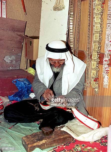 Saudi craftsman repairs a dagger in Riyad's traditional market at opening of the 15th Janadiriyah cultural festival in Riyadh The twoweek annual...