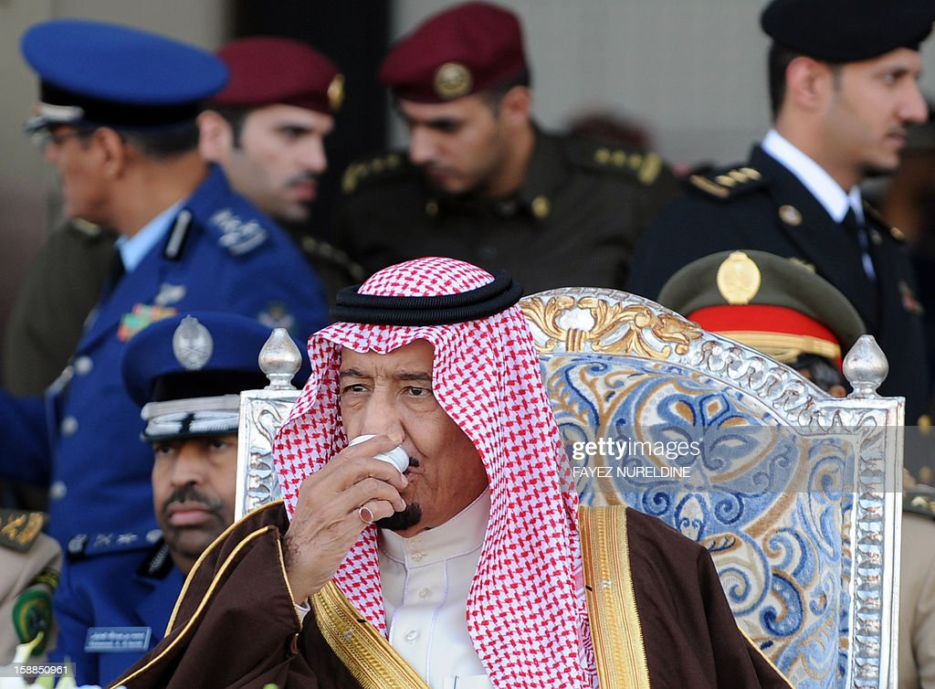 Saudi Crown Prince, Deputy Premier and Minister of Defense Salman bin Abdulaziz drinks coffee as he attend the graduation ceremony of the 83rd batch of King Faisal Air Academy (KFAA) students at the Riyadh military airport, on January 1, 2013 in Riyadh.