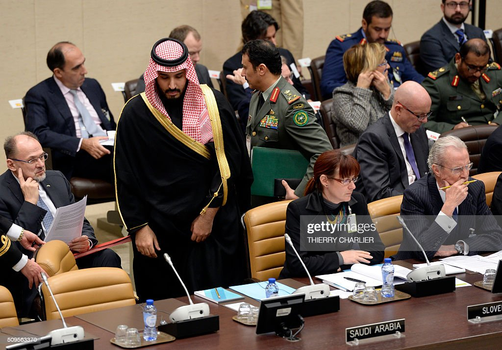 Saudi Defence Minister Mohamed bin Salman (2L) arrives to attend the Global Coalition meeting against ISIS held at NATO headquarters in Brussels, February 11, 2016, next to Slovenian Defence Minister Andreja Katic. NATO launched an unprecedented naval mission in the Aegean Sea to tackle people smugglers taking migrants and refugees from the Turkish coast, Secretary General Jens Stoltenberg said on Thursday. / AFP / THIERRY CHARLIER