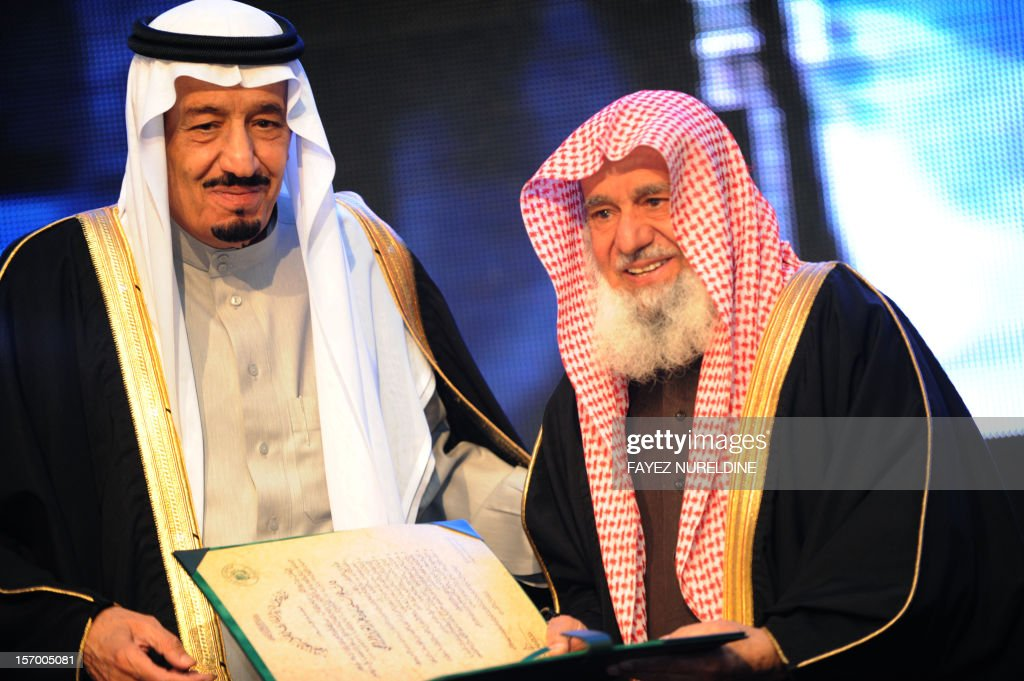 Saudi Defence Minister Prince Salman bin Abdul Aziz (L) gives the King Faisal International prize to Sheikh Sulaiman bin Abd Al-Alaziz Al-Rajhi from Saudi Arabia for his service to Islam during the award ceremony in Riyadh on March 06, 2012.