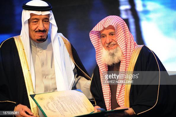 Saudi Defence Minister Prince Salman bin Abdul Aziz gives the King Faisal International prize to Sheikh Sulaiman bin Abd AlAlaziz AlRajhi from Saudi...