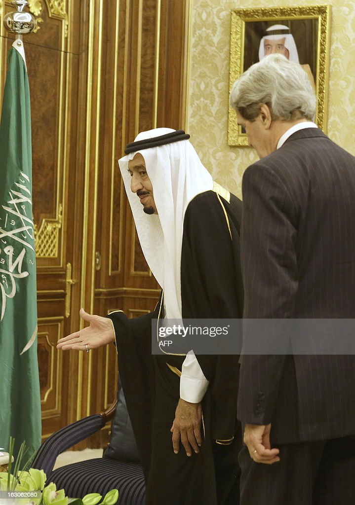 Saudi Deputy Foreign Minister Prince Abdulaziz bin Abdullah invites U.S. Secretary of State John Kerry, to take his seat at the start of their meeting at Yamamah Palace in Riyadh, on March 4, 2013. Saudi Arabia is the seventh leg of Kerry's first official overseas trip.