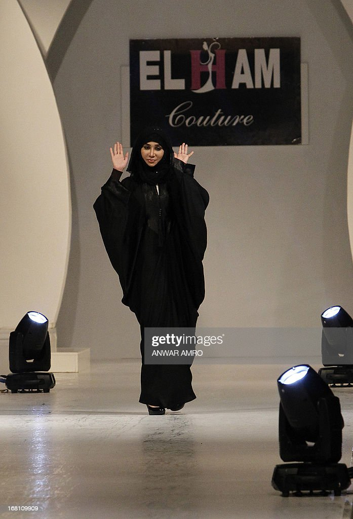 Saudi designer Elham Elyoussef salutes the crowd following a fashion show in Beirut on May 5, 2013.